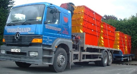Lorry loaded with skips